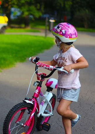 A likeness of Elodie permanently clad in her pink cycle helmet.