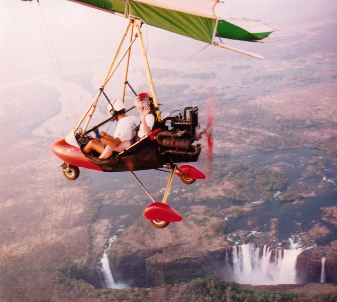 Microlight_over)Victoria_falls_sunset