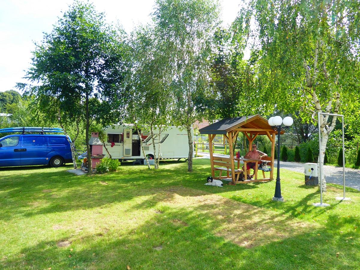 Caravan in pleasant green campsite